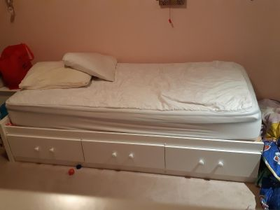 White twin sized captains bed