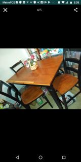 Nice tall kitchen table has 4 chairs (other chair is in living room)