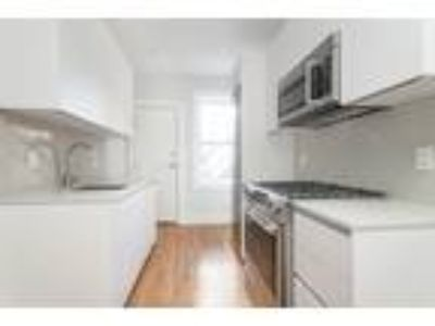 This great Two BR, One BA sunny apartment is located in the area on Forest St.