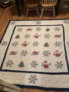 Beautiful hand sewn queen Christmas quilt.
