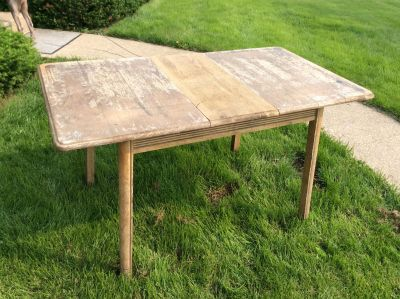 Antique solid oak table with removable leaf. 30 & 1/2 x 55 x 29 1/2 H.