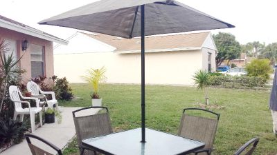 Table and Chairs and Umbrella