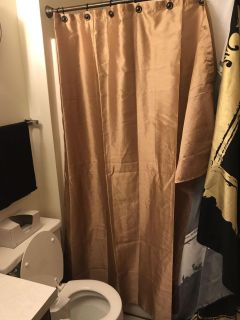 Gold shower curtain comes with solid black curtain liner