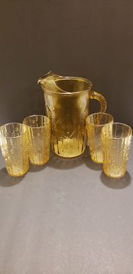 Beautiful vintage yellow glass pitcher with glasses