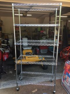 5 tier metal shelf with wheel (have 2 of them)
