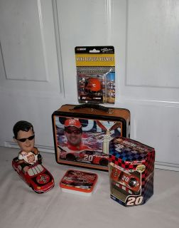 Tony Stewart Group. Lunch box, mini helmet, 1/64 car never opened, bobble head in race car, & small ton. All for $12