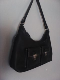 Black purse. Lots of pockets. Great condition.