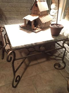 Marble top table w Wrought iron base $150