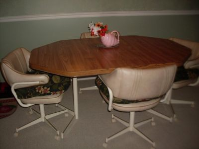 dining table and 4 chairs plus leaf.