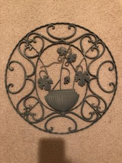 Beautiful metal decor , painted grey , can be repainted to your liking ! Measures 19 across