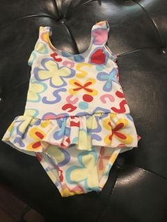 Infant bathing suit. Says 6-12 months but is very small. In good used condition, smoke free home.