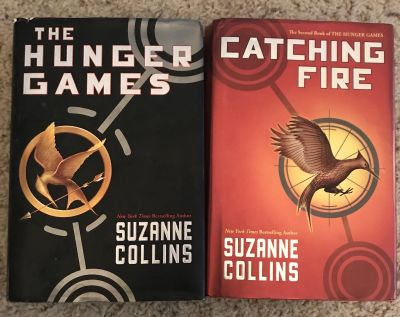 Two Suzanne Collins hardback books in the Hunger Games series