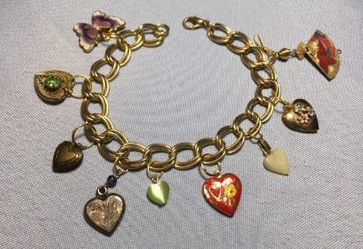 Charm Bracelet Vintage Lockets and Hearts Gold Colored Metal Fan which Opens and Closes One of a...