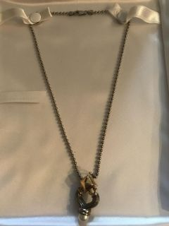 18k and sterling silver pearl pendent and sterling silver chain.