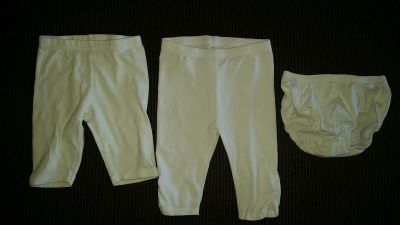 Size 12-18months. Very WHITE!