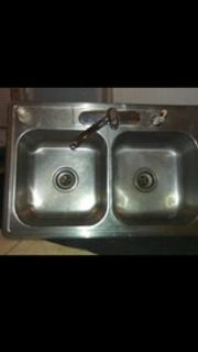 stainless steel kitchen sink with moen faucet and sprayer