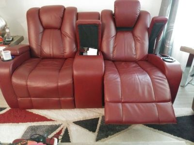 A loveseat with two recliners and more