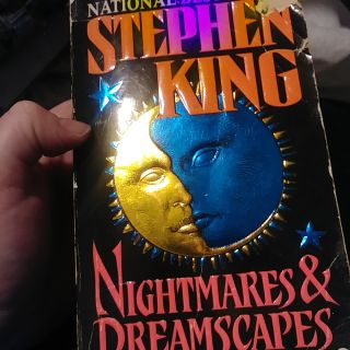 Nightmares & Dreamscapes book, front and back cover has rip, pages in book in good c