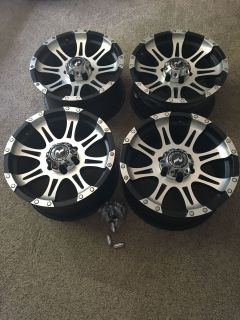 4 Used Wheels and Lug Nuts