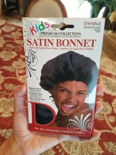 New in package black satin sleep bonnet children's size but I have a small head and wear this size