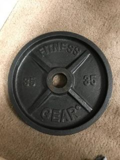 Pair of 35 pound Olympic iron weight plates