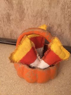 Basket with cute candy corn fabric pieces! Near 46 and 2722.