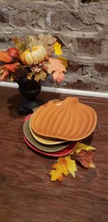 """Set of 4 Fall Pumpkin Plates by Tag. Orange, Yellow, Green and Red. 7.75"""" L x 7.5"""" W. Dishwasher & Microwave Safe."""