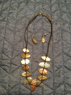 Hand crafted set purchased at Christkindlmarkt. Beautiful multi tones. Set was $40 New. Worn gently. Firm price.
