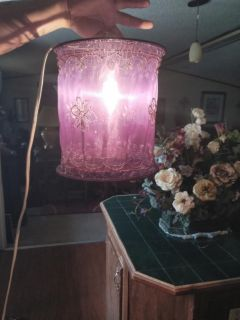 Purple sheer hanging light with beaded decor. Very pretty detail.
