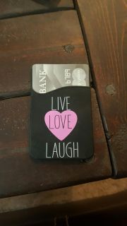 Card holder with adhesive back