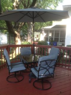 Outdoor table/4 rocker chairs/umbrella with stand and chair pads