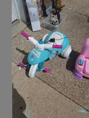 Small Frozen motorized Tricycle.