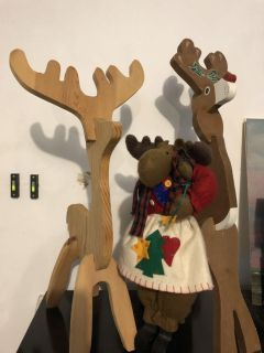Two wood reindeers and a moose