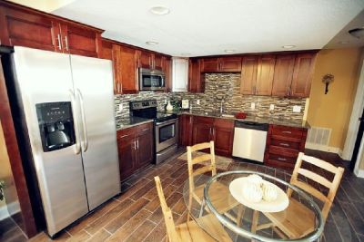 Deck Up Your Kitchen With Cherry Cabinets from GEC