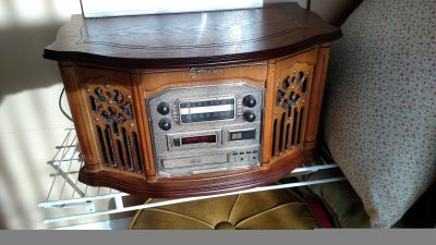 Radio, vinyl records player, CD player too. I'm not sure if the cassette player works I don't have a cassette to put in it.