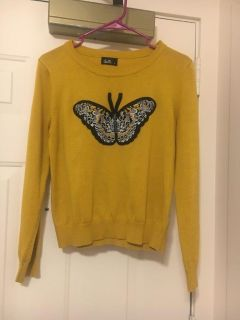 Mustard top with a butterfly