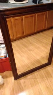 Mirror, older, 41 in x 29. Could hang either way.