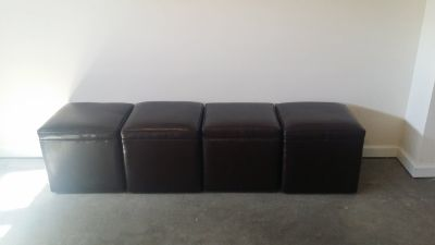 4 leather ottomans with wheels