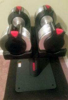 Weider adjustable dumbbell set and stand.