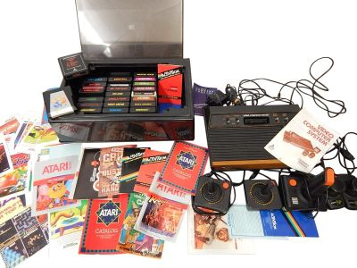 Vintage 1980 Woody 4-Switch ATARI (CX-2600A) Video Game System with Storage Case, 25 Games, 5 Controllers, Manuals, Ephemera, and Extras