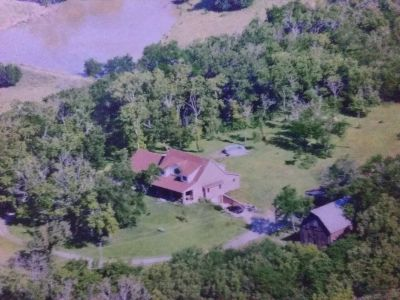 4-4 2 car garage ,2 barns , shop, 10 acres