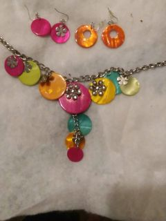 Bright colors necklace on a thick silver chain comes with two pairs of ear rings so they match the neclace