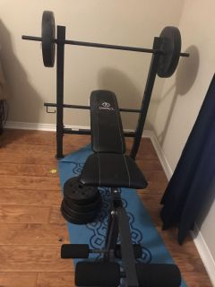 Marcy bench with 100 lbs of weights