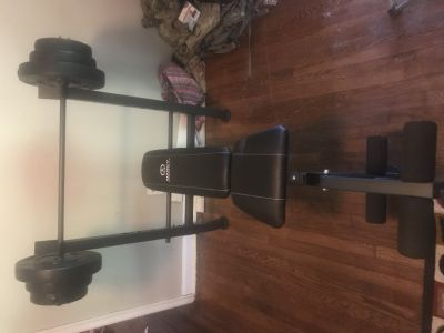 Weight bench with 100 pounds of weight