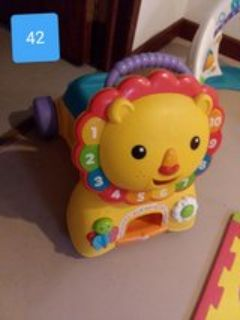 ride or push lion toy
