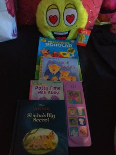 Four books one is tracing emoji plush and cards