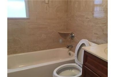 This Is A Great 3 Bedroom Apartment With A Brand New Modern Bathroom. Single Car Garage!