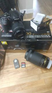 Nikon D3400 with Extra lens, remote, cases, etc