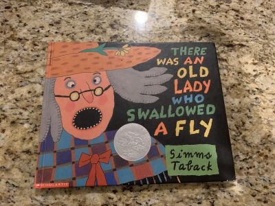 Hardcover book there was an old lady who swallowed a fly