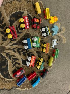18 wooden magnetic trains with zoo animals. EUC